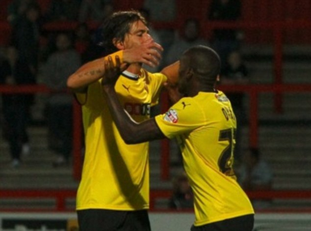 Hornet's sting: Lloyd Dyer celebrates after scoring the wining goal in the Capital One Cup