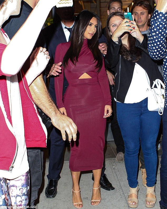 Mobbed: The fashion designer was seen taking pictures with doting fans