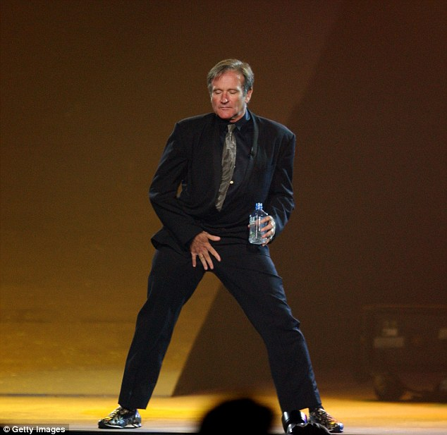 For laughs: Robin Williams performs at the 7th Annual Andre Agassi Charitable Foundation's Grand Slam for Children benefit concert on September 28, 2002 at the MGM Grand Hotel in Las Vegas, Nevada