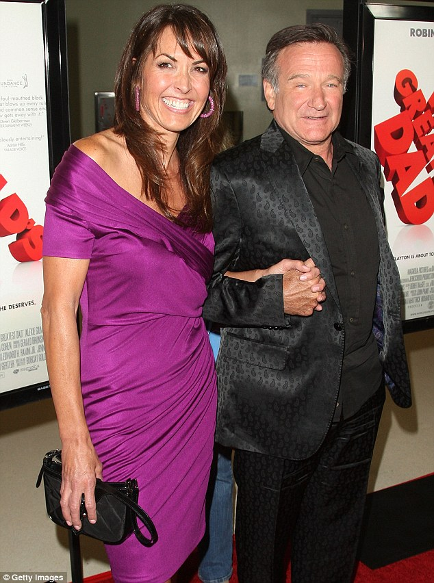 Utterly heartbroken: The Academy Award winner's wife Susan Schneider (pictured alongside the actor at the premiere of his film World's Greatest Dad in 2013) confirmed the tragic news of his death in a statement