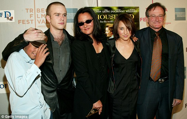 United: Williams was surrounded by his family at a screening for House Of D in 2004 (L-R) his sons Cody Alan and Zachary Pym, his former wife Marsha Garces Williams and daughter Zelda Rae