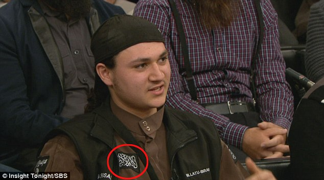 The teenager turned up to the discussion wearing an Islamic State flag on his black jacket