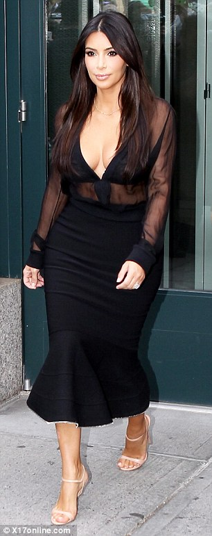 Sheer daring: The reality star looked incredible in a plunging sheer blouse and a striking fishtail skirt