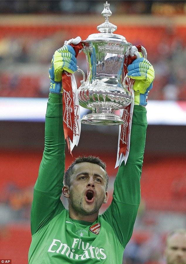 Glory boy:Lukasz Fabianski celebrates winning the FA Cup with Arsenal in May