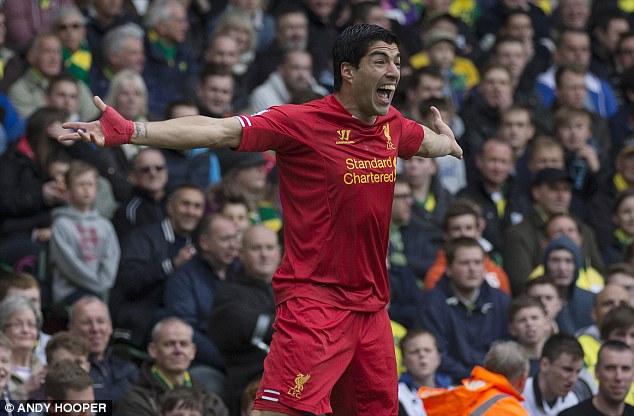 Good riddance: Premier League chief executive Richard Scudamore says he's happy to see Luis Suarez leave