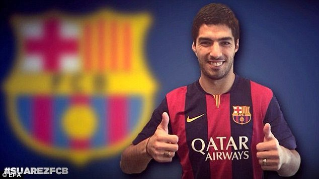 All smiles: Suarez joined Barcelona in a £75million deal from Liverpool in July