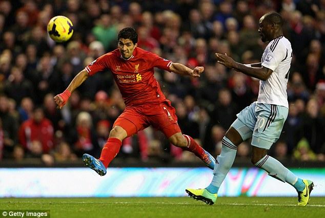 Dynamite: Suarez (left) scored 31 Premier League goals last season as Liverpool finished second