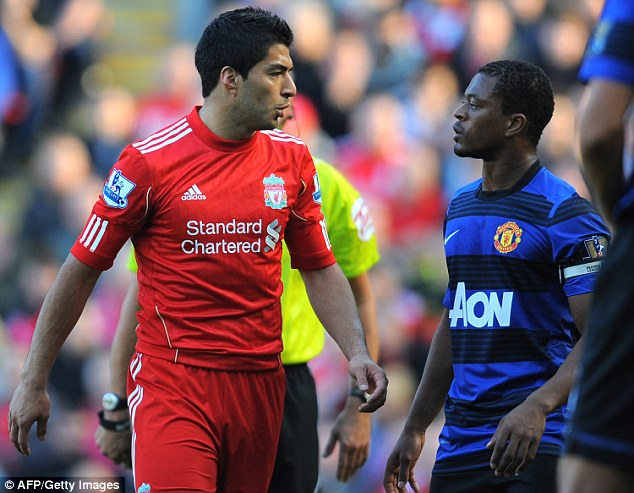 Disgrace: Suarez (left) was given an eight-match ban for racially abusing Patrice Evra (right) in 2011