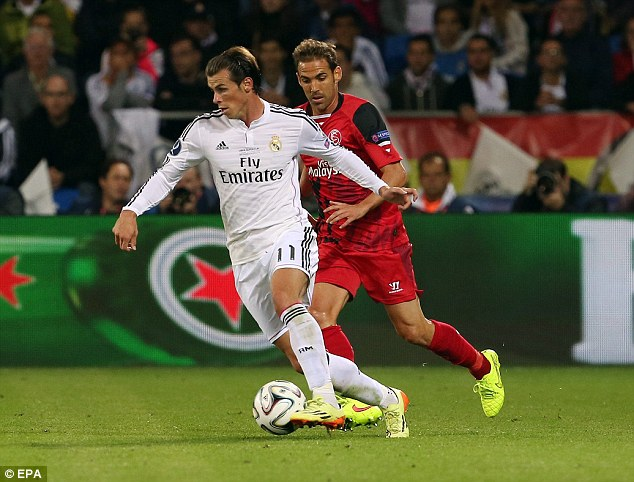 On the ball: Gareth Bale left Tottenham to join Real Madrid for a world record £86million fee last summer