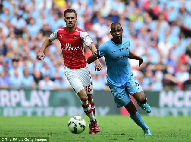 Tough competition: Arsenal (left) and Manchester City (right) will be challenging for the Premier League title
