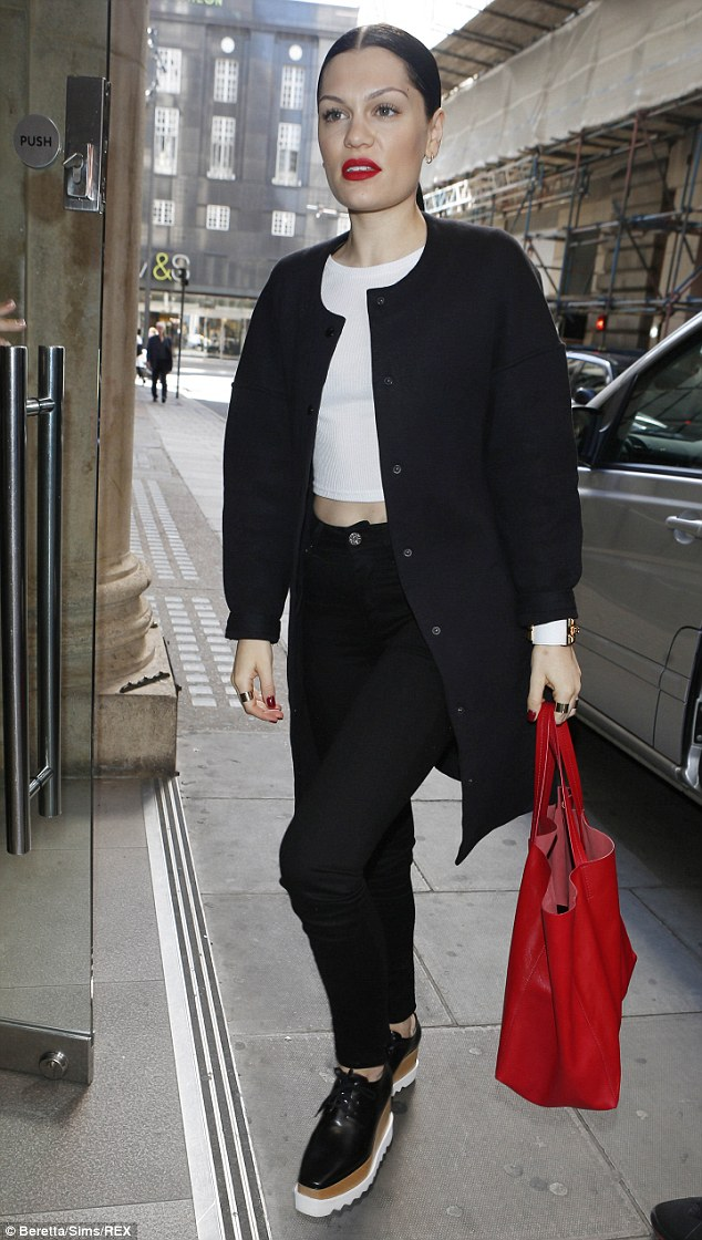 Black and white and red all over: Jessie J cut a stylish figure when she stepped out in London on Wednesday