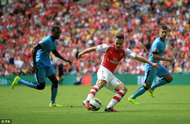 On fire: Aaron Ramsey scores for Arsenal in Sunday's Community Shield clash against Manchester City