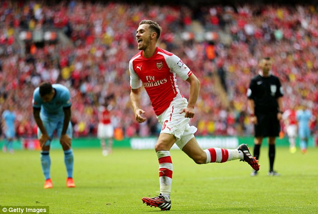 Pick that one out! Ramsey celebrates his goal and is hoping for another  prolific season for Arsenal