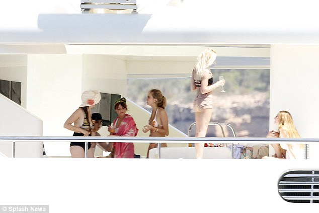 Atmospheric: The party crew enjoyed glasses of champagne during their cruise