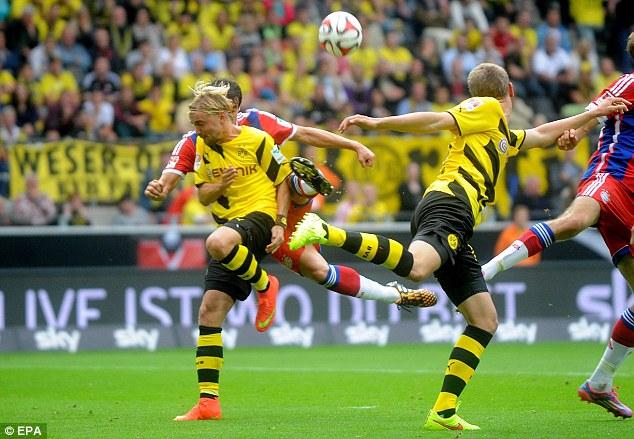 Awkward: Martinez injured his knee in a duel with Dortmund's Marcel Schmelzer