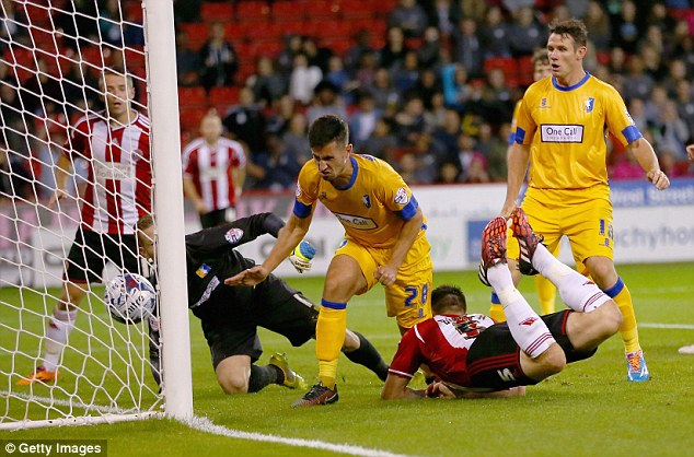 Opener: Andy Butler of Sheffield United scores the first of the night at Bramall Lane
