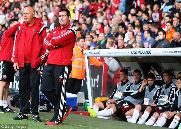 In the dugout: Sheffield United manager Nigel Clough (right) and assistant manager Andy Garner