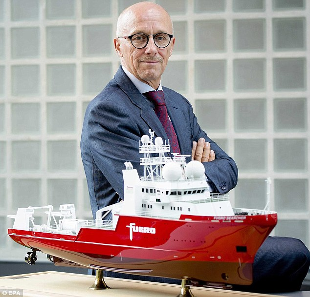 Fugro CEO Rob Luijnenburg with a model of the two ships which are involved in the search for Malaysia Airlines flight MH370