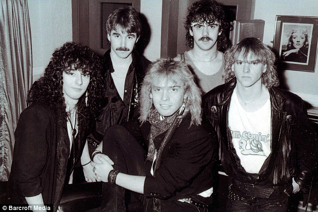 Abby still living as Mark (centre), while playing with an eighties rock group in Manchester