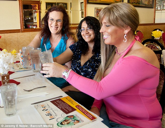 Abby, pictured here with transgender friends Dahlia (far left) and Annie, is planning on paying the $17,000 fee for the gender reassignment operation in March next year using money from the sale of her house