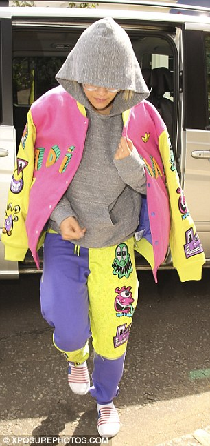 Quirky style icon: The singer was travelling in a daring 80s inspired ensemble