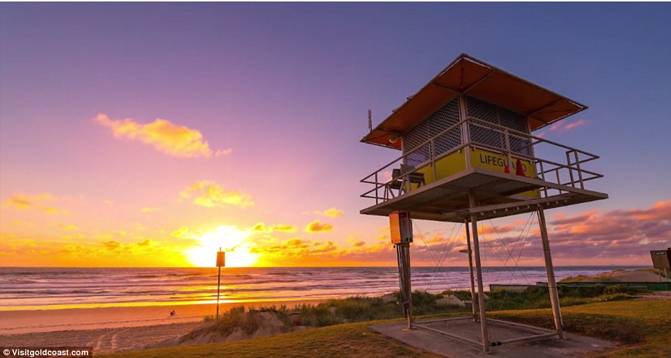 The video opens on a serene sunrise over one of the Gold Coast's stunning beaches
