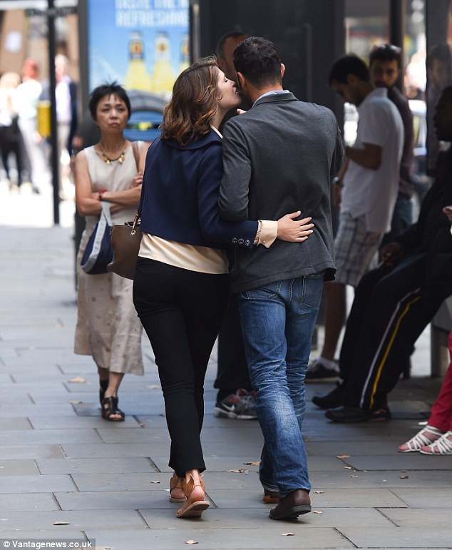 Before anyone else... Gemma, 28, was seen placing a tender kiss on the French film director's cheek