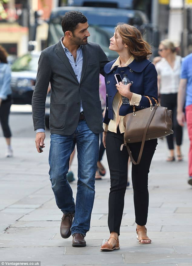 Besotted: The couple only had eyes for each other as they walked side by side in Chelsea