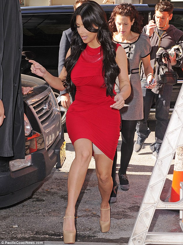 Peek-a-boo! Kim flashed her shapewear underneath a tight red dress in New York in 2011