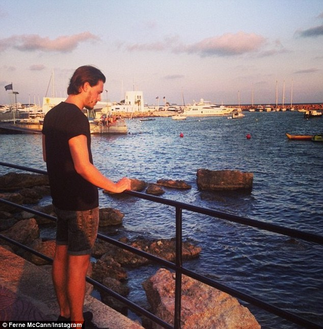 Scenic: The brunette posted this photo of her beau as he looked out to sea, after teaming a black Tee with denim shorts