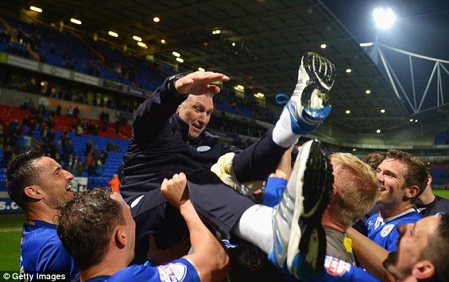 Worthy winners: Nigel Pearson is mobbed by his jubilant Leicester players as they secured the Championship title at Bolton back in April. They went on to amass 102 points and return to the top flight after a decade