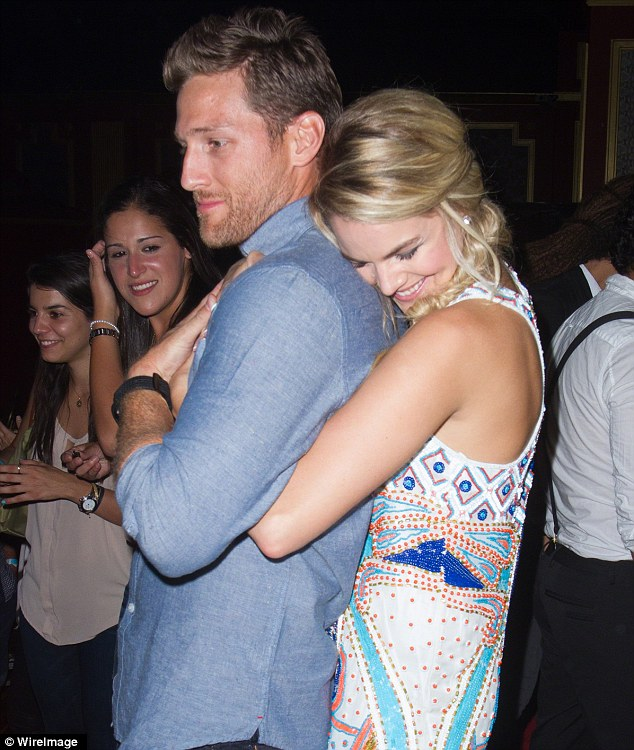 Close couple: Nikki squeezed Juan Pablo from behind at the bash