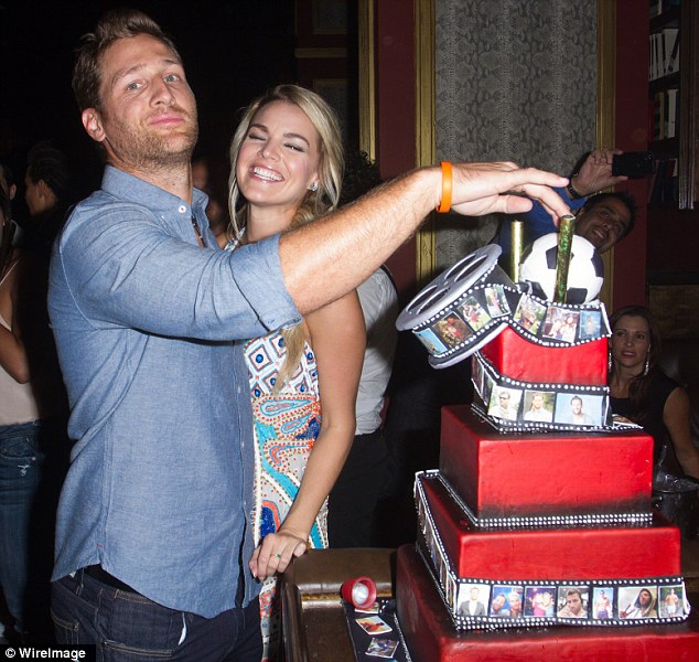 Goofing around: Juan Pablo made Nikki laugh as he played with his specially made cake