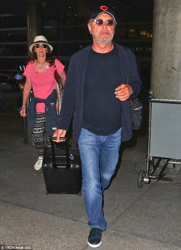 Downcast: Billy Crystal arrived at LAX on Wednesday, two days after news of his dear friend Robin Williams' passing