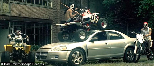 Just hanging around: These guys made a silver car their own outside the decrepit building