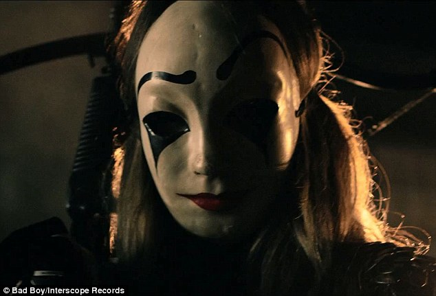 Scary: In what appeared to be something out of horror movie The Purge, Khloé first appeared behind this painted mask