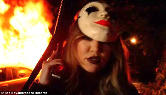 She can do scary! The 30-year-old Keeping Up With The Kardashians star had dark red lips and a menacing smile as she stood in front of a car on fire