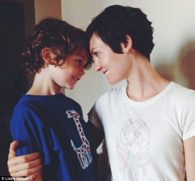 Parenting: Blogger and mother-of-three Lizzie Heiselt (pictured with her son) has sparked a heated debate after revealing that she sometimes leaves her seven-year-old son home alone for up to 45 minutes at a time