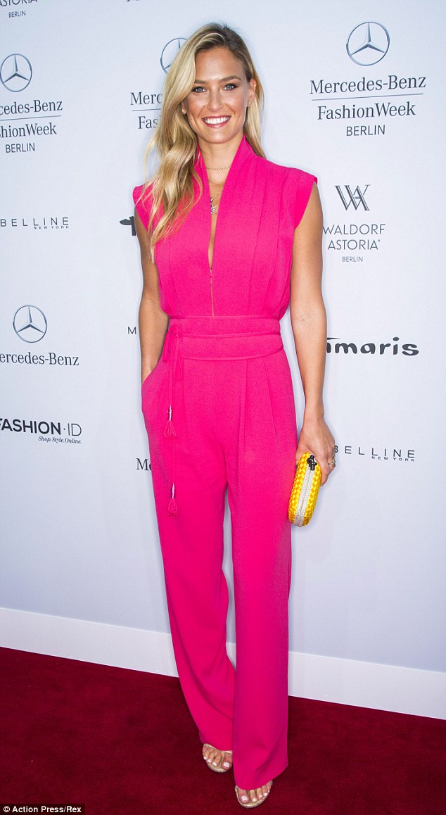 Blonde ambition: The supermodel looked radiant in a pink jumpsuit at Berlin Fashion Week in July