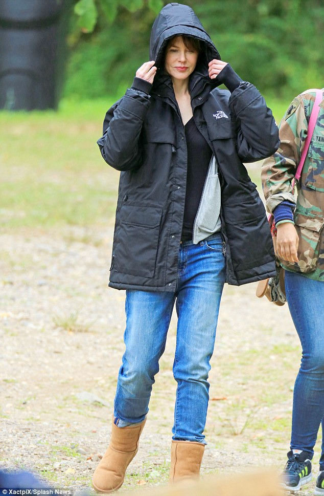 So Aussie! In between takes, the former wife of Tom Cruise kept warm in a blue sleeveless body warmer, and later got so cold she also donned a bulky black coat and a pair of Ugg boots