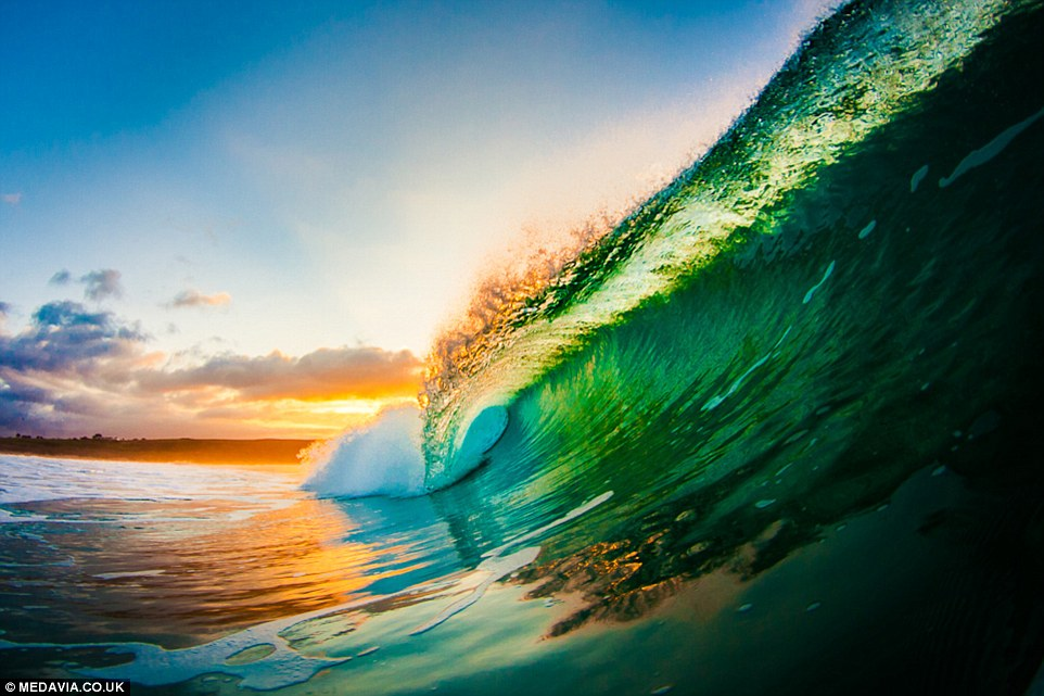The sunrises create some incredible, vivid colours as they catch the tips of the crashing waves, like these at St Ives Bay (Hayle)