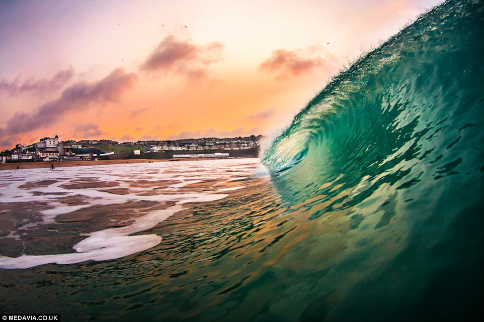 The surf instructor goes all over Cornwall to take the photographs, which he then compiles into calendars and sells. This one is fromPorthmeor (St Ives)