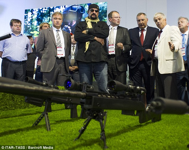 Posing: Steven Seagal appeared at the display of Russian military might alongside high-ranking army figures