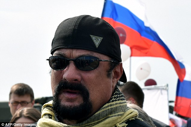 Flag: The star was picturedd in front of the red, white and blue flag of the Russian state