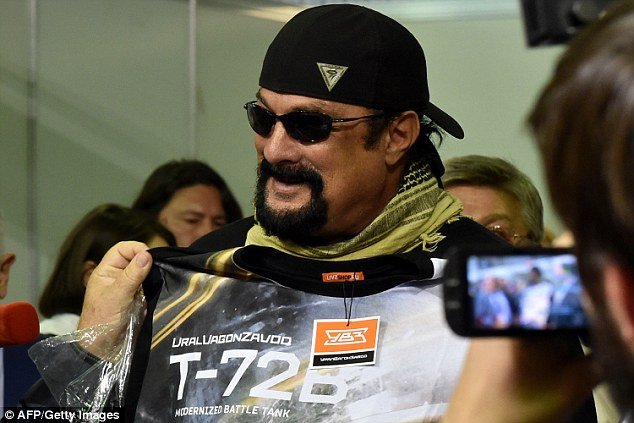 Got the t-shirt: Seagal even posed with clothing from the event