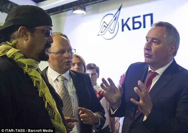 Friends in high places: Seagal was seen in discussion with Russian deputy prime minister Dmitry Rogozin