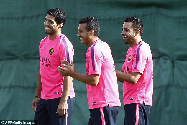 All smiles: Barcelona are well under way with pre-season preparations, while Suarez has been training alone