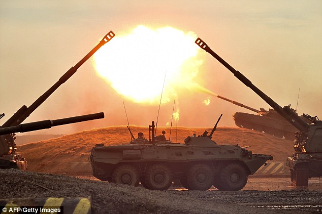 Volga display of power: Outside at the exhibitons tanks were seen launching rounds into the sky