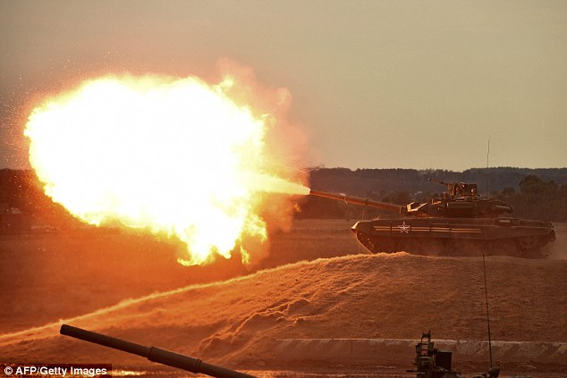 Flaming might: Tanks rolled across an open filed at the military exhibition