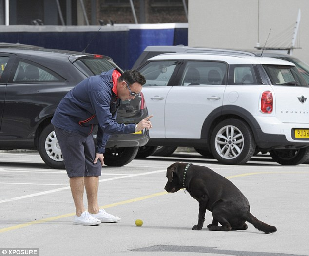 Bit ruff: The 38-year-old showed off his stern side as he trained his dog
